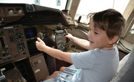 Child checking out the cockpit of a plane