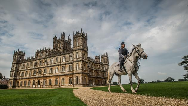 Countess of Carnarvon on horseback in front of Highclere Castle