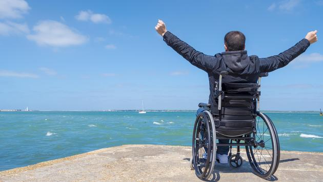 Disabled traveler watching the sea