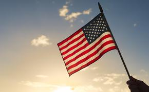 A person holding the American flag