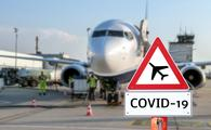 Airplane with a coronavirus warning sign concept in the foreground.