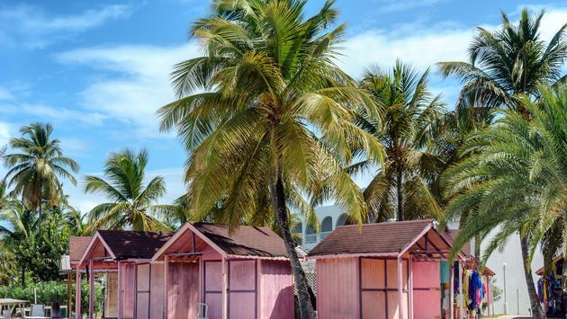 Pink beach huts on tropical Antigua island