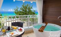 $1,000 Instant Credit: Beachfront Club Level Suite with Balcony Tranquility Soaking Tub