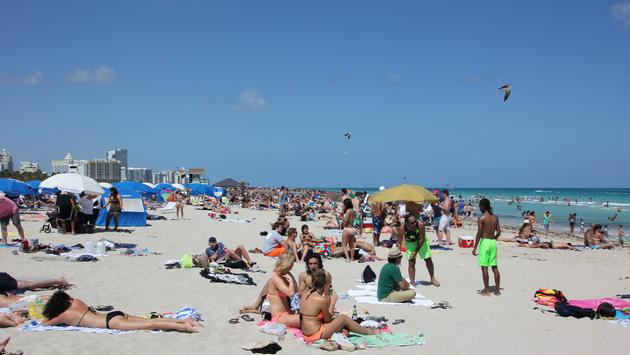 People enjoying South Beach in Miami Beach, Florida