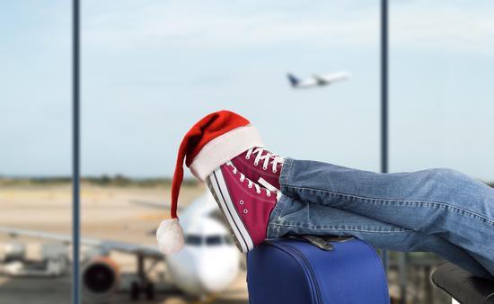 Traveler with Santa hat in airport