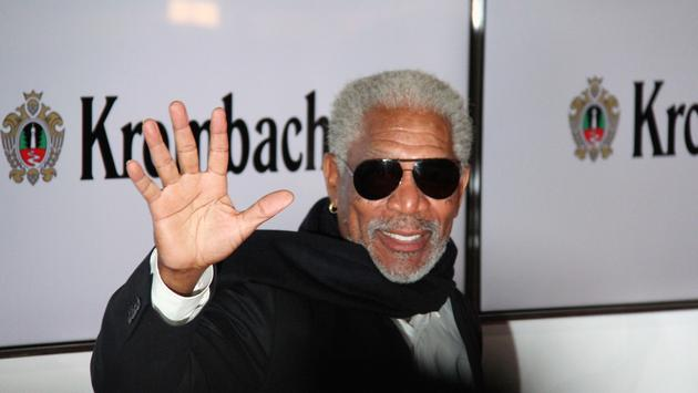 Morgan Freeman waving at an event