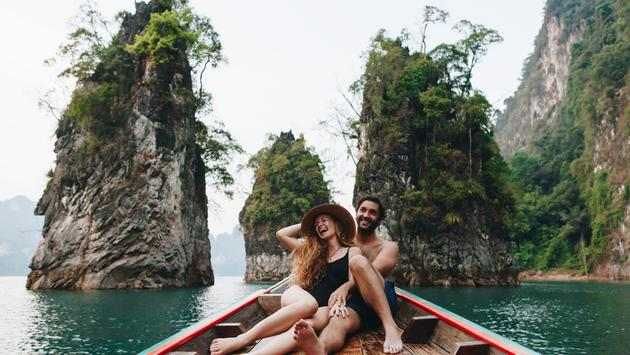 Couple relaxing on a boat in Thailand