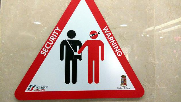 Pickpocket warning sign in Turin, Italy
