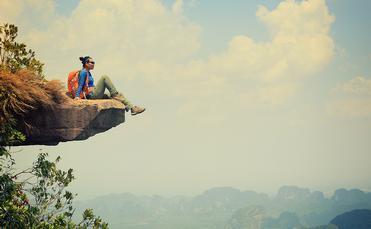 Woman adventure traveler hiker