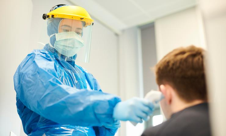Medical worker wearing personal protective equipment.