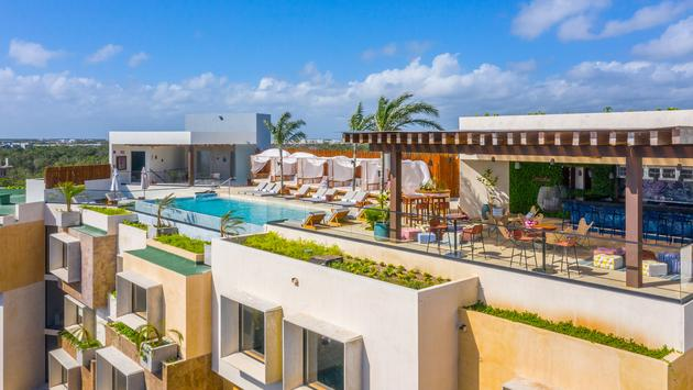 Rooftop pool with rooftop bar and pool cabanas