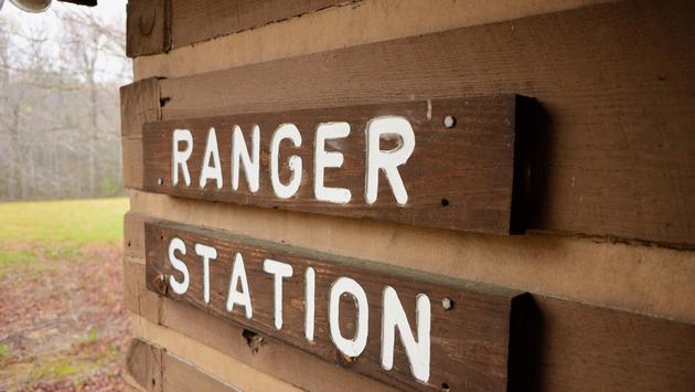 Ranger station sign on cabin