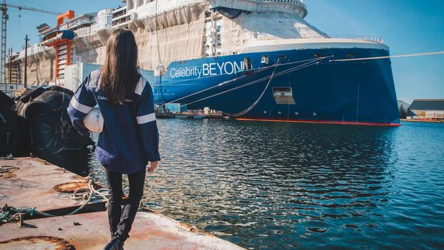 Captain Kate McCue, the first American female cruise ship captain, watches as construction continues on Celebrity Beyond at the Chantiers de l'Atlantique shipyard in Saint-Nazaire, France.