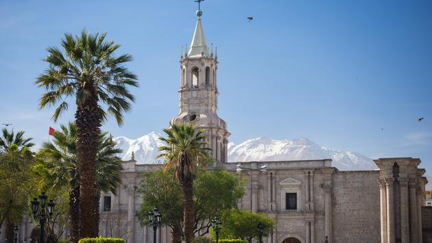 Cathedral and snowcapped volcano in Arequipa, Peru