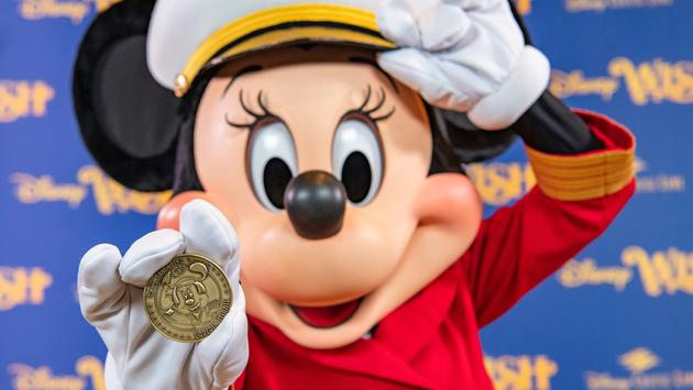 A commemorative coin created for the Disney Wish features Captain Minnie.
