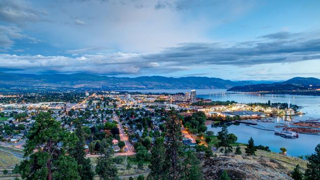 Aerial View of Kelowna, British Columbia, just after sunset on Knox Mountain, Canada. (Photo via ronniechua / iStock / Getty Images Plus)