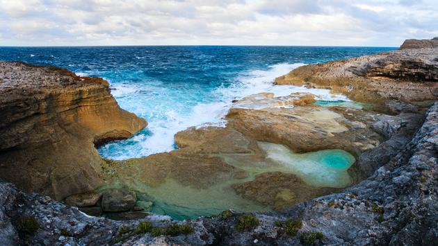 Natural baths at rocky coast of Eleuthera island, Bahamas (photo via shalamov / iStock / Getty Images Plus)