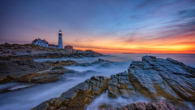 Portland Head Lighthouse in the pre-dawn light. Portland Head Light is an historic lighthouse in Cape Elizabeth, Maine. The light station sits on a head of land at the entrance of the primary shipping channel into Portland Harbor, which is within Casco Ba