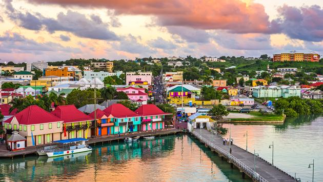 St. John's, Antigua port and skyline at twilight. (Photo via Sean Pavone / iStock / Getty Images Plus)
