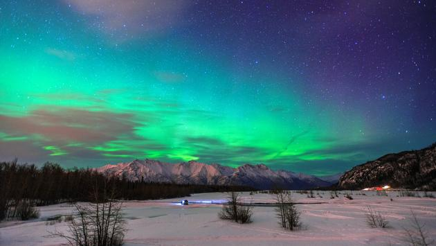 Beautiful green Northern light (Aurora Borealis) at Knik River in Alaska. (Photo via CNaene / iStock / Getty Images Plus)