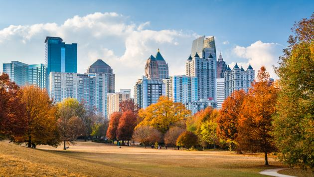 Atlanta, Georgia, USA skyline from Peidmont Park. (photo via Sean Pavone / iStock / Getty Images Plus)