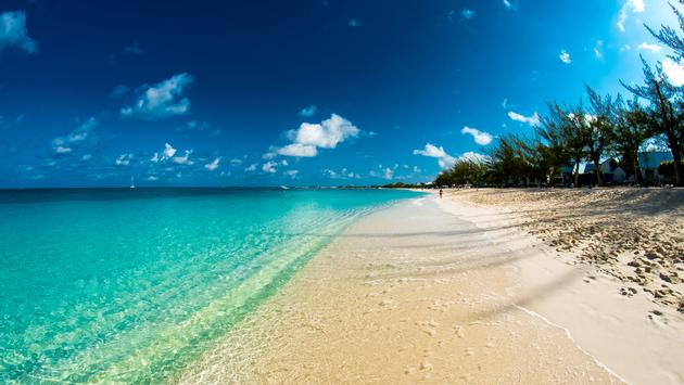 Image of the beach on Grand Cayman Island. (Photo via  WGCPhotography / iStock / Getty Images Plus)