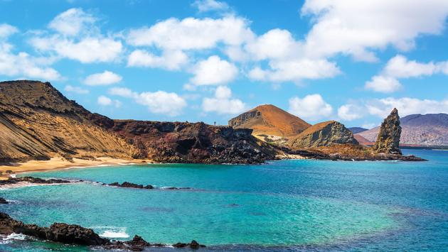 Bartolome Island, a perfect spot to enjoy the sunset on the Galapagos Islands (photo via boydhendrikse/iStock/Getty Images Plus)