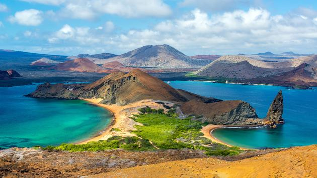 View of two beaches on Bartolome Island in the Galapagos Islands in Ecuador (photo via DC_Columbia/iStock/Getty Images Plus)
