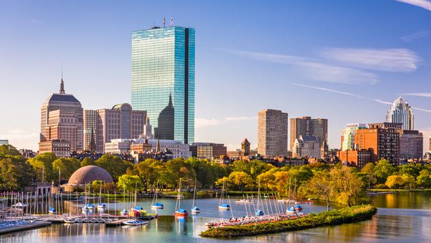 Boston, Massachusetts, USA city skyline on the river. (Photo via  Sean Pavone / iStock / Getty Images Plus)
