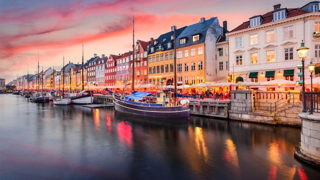 Copenhagen, Denmark on the Nyhavn Canal. (photo via SeanPavonePhoto / iStock / Getty Images Plus)