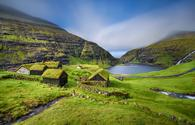 Village of Saksun located on the island of Streymoy, Faroe Islands, Denmark. Long exposure. (photo via miroslav_1 / iStock / Getty Images Plus)
