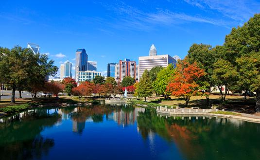 Charlotte skyline from Marshall Park in the fall. The new Skye condos are in the middle. (Photo via  JillLang / iStock / Getty Images Plus)
