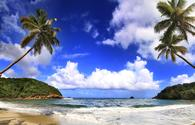 Beautiful beach in Dominica (photo via gydyt0jas / iStock / Getty Images Plus)
