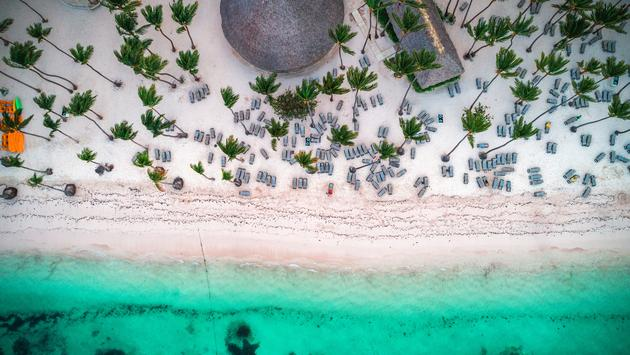 Aerial view of tropical island beach. Dominican Republic. (photo via valio84sl / iStock / Getty Images Plus)