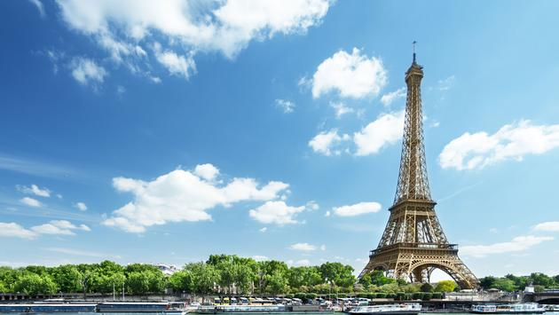 Seine in Paris with Eiffel tower in morning time (photo via IakovKalinin / iStock / Getty Images Plus)