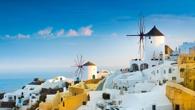 View of Oia the most beautiful village of Santorini island in Greece (photo via prosign/iStock/Getty Images Plus)