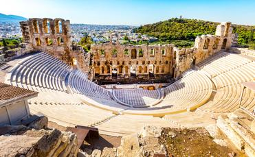 Ancient Amphitheater of Acropolis of Athens, landmark of Greece (photo via Kisa_Markiza/iStock/Getty Images Plus)