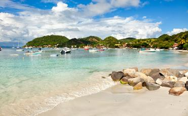 The beach of Terre-de-haut, Les Saintes in Guadeloupe (photo via eyewave/iStock/Getty Images Plus)