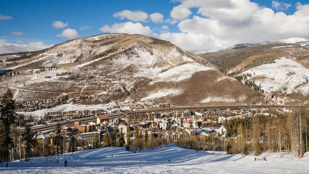 View of village of Vail in Colorado and Interstate 70 from skiing slopes. (photo via miralex / iStock / Getty Images Plus)