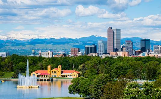 Denver Colorado downtown with City Park (photo via photoquest7 / iStock / Getty Images Plus)