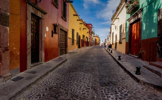 The many backstreets of San Miguel de Allende in Mexico can be quiet, colorful and beautifully preserved. A wonderful serene place for a morning or evening walk. (photo via thupton / iStock / Getty Images Plus)