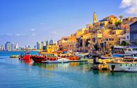 Old town and port of Jaffa and modern skyline of Tel Aviv city, Israel (photo via Xantana / iStock / Getty Images Plus)