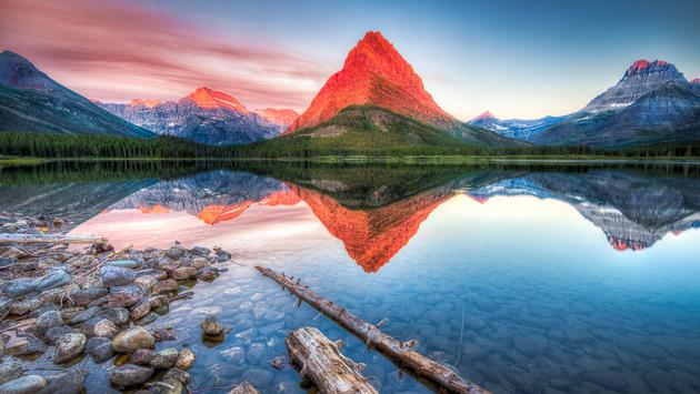 Stunning reflections on Swiftcurrent Lake in northern Montana at sunrise (Dean_Fikar / iStock / Getty Images Plus)