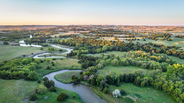 aerial view of Dismal River in Nebraska Sand Hills near Thedford, spring scenery lit by sunrise light (marekuliasz / iStock / Getty Images Plus)