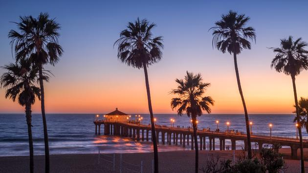 Manhattan Beach Pier at sunset, Los Angeles, California (Photo via choness / iStock / Getty Images Plus)