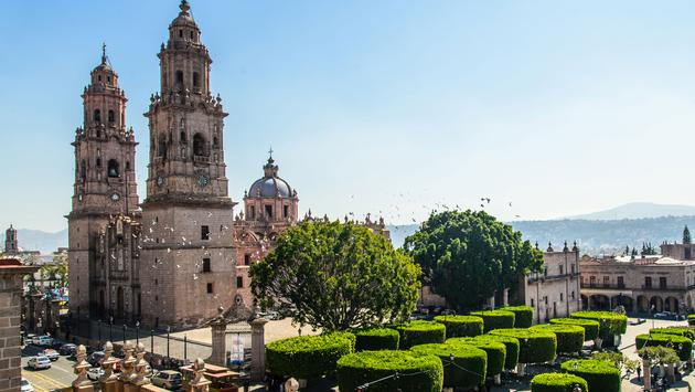 High point of view of Morelia Cathedral and town square. (photo via Esdelval / iStock / Getty Images Plus)