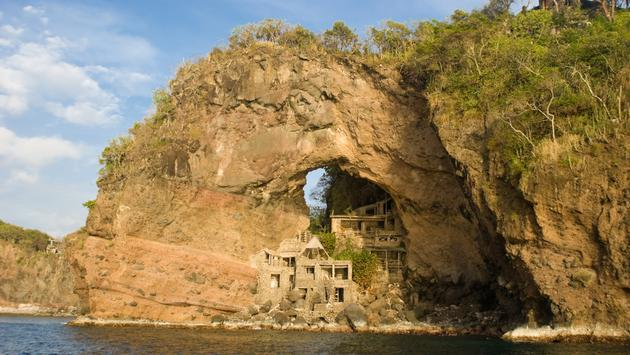 Abandon Art Colony at Adams Bay on thge island of Bequia, Grenadines. Unique tourist destination builted in the 60's, The arch is also refered to as the Moonhole (photo via Aneese / iStock / Getty Images Plus)