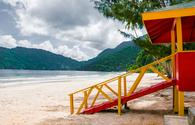 Maracas beach trinidad and tobago lifeguard cabin side view empty beach (photo via Altinosmanaj / iStock / Getty Images Plus)