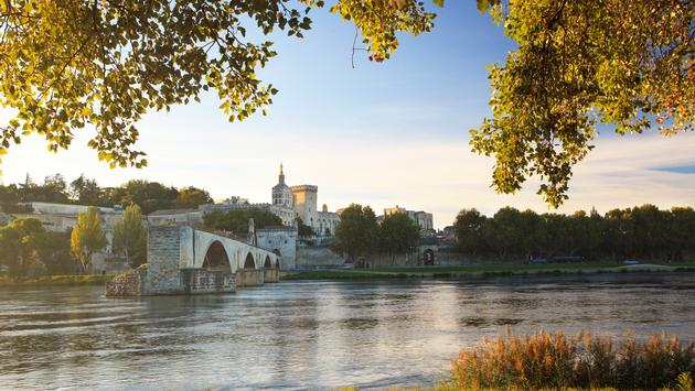 Avignon Bridge with Pope's Palace and Rhone river, Provence, France (photo via HonzaHruby / iStock / Getty Images Plus)