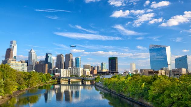 Downtown skyline and Schuylkill River in Philadelphia, Pennsylvania, USA (Photo via dibrova / iStock / Getty Images Plus)